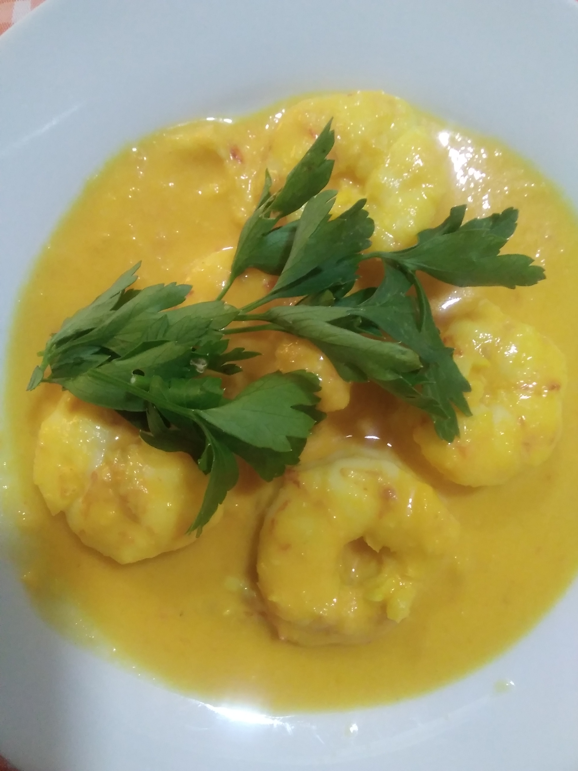 Langostinos al curry